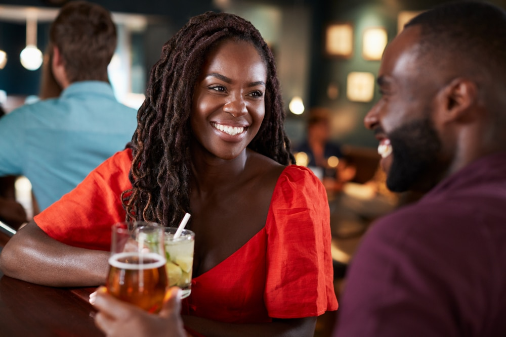 A young couple enjoying their drinks and other romantic things to do in Nashville TN